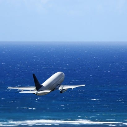 """<img scr="""" Airplane over ocean.jpg"""" alt=""""Take a family vacation by air, Omaha, Enchanted Honeymoons"""">"""