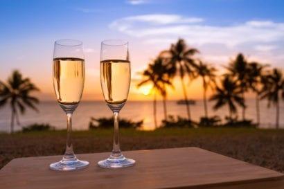 affordable honeymoon romantic champagne on beach