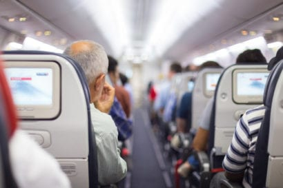 man waiting patiently on airplane