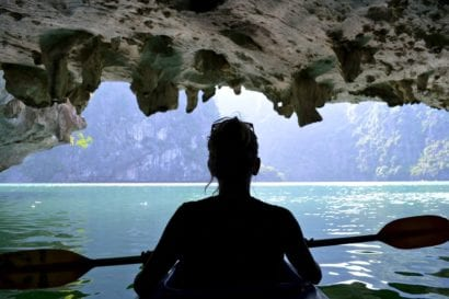 woman kayaking in cave