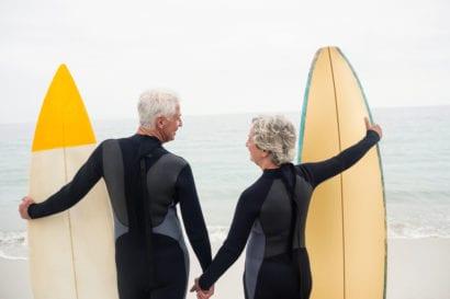 senior couple surfing