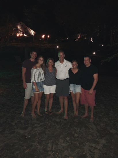 Family on beach in costa rica at night