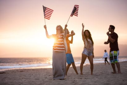 family celebrating Independence day on the beach