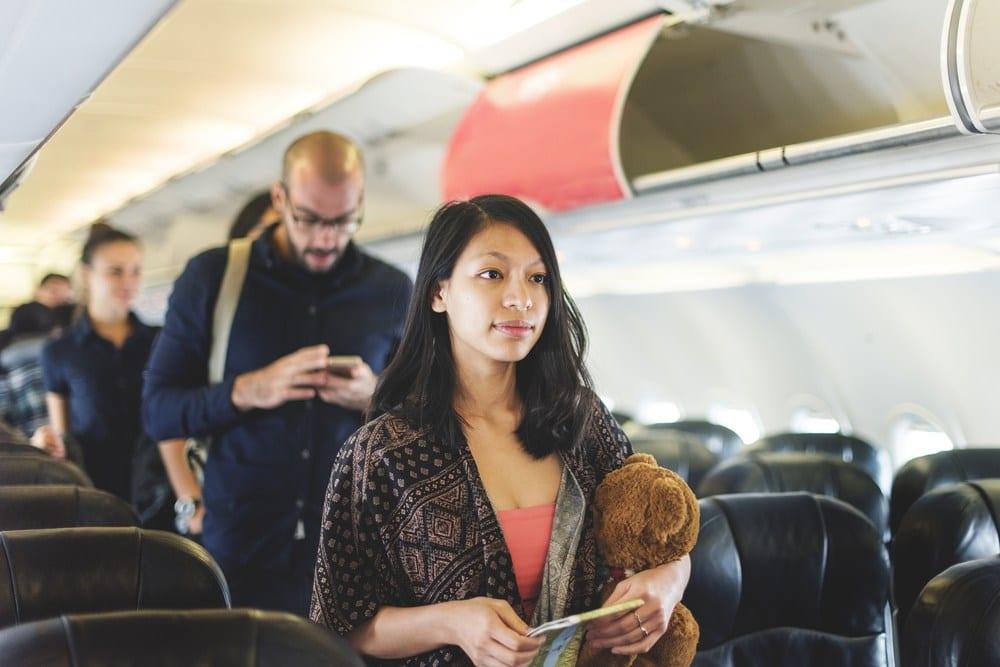 Woman walking off of plane