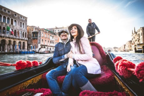 Couple in river boat in Europe