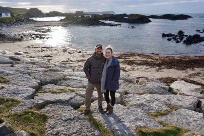 Couple standing on beach in Ireland