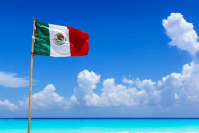 Mexico flag on beach